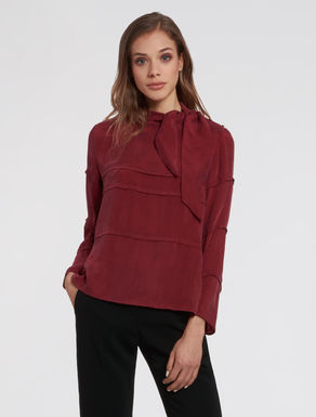 Flowing blouse with bow