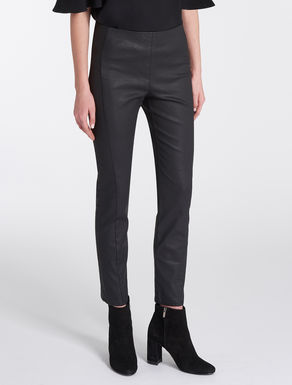 Coated cotton skinny trousers